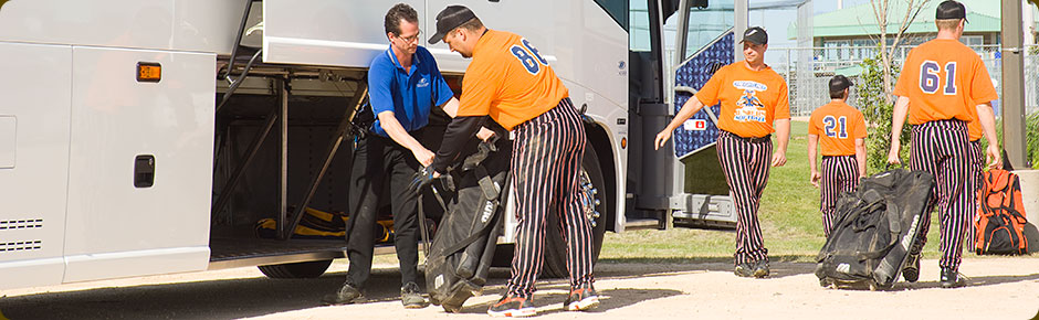Baseball Players Unloading Gear from Motor Coach